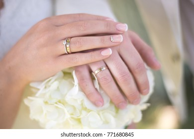 Wedding rings and decorations, hands