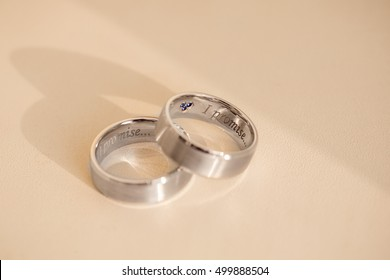 Wedding rings with engraving text ''I promise'', creative and amazing wedding rings for bride and groom