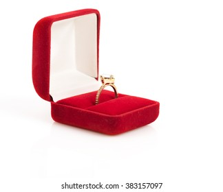 wedding rings in a gift box on white background