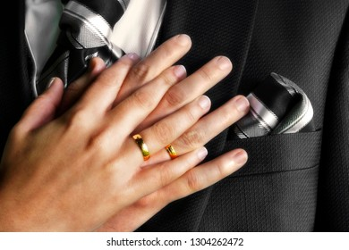 wedding rings and hands of newlyweds
