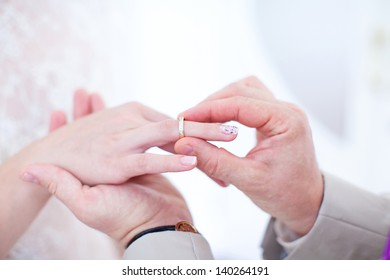 Wedding rings and hands of the newlyweds