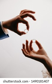 wedding rings in hands on the white background