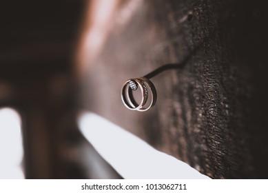 Wedding rings hang on the wall
