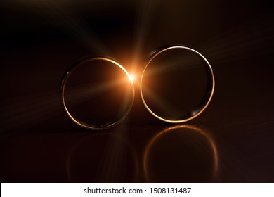 Wedding rings with lens flare. Macro image.