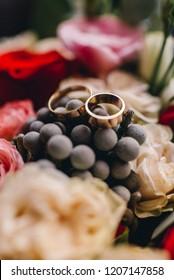 Wedding rings lie on the flowers