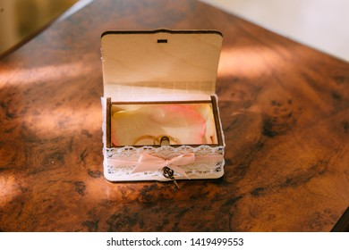Wedding rings lie on a white pillow in a registry office. Happiness to marry a loved one, happiness in marriage. Official registration of marriage in the registry office