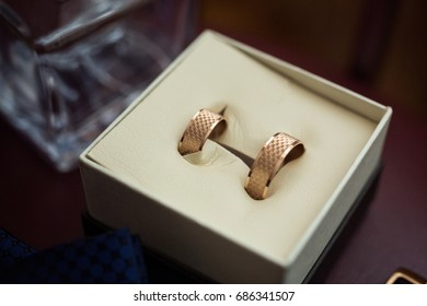 wedding rings lie in the wooden box  as bridal accessories