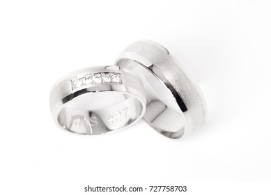 Wedding rings made of white gold, partly matted surface, with diamonds for her.