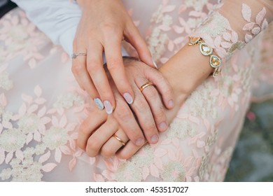 wedding rings. Newly wed couple's hands with wedding rings. Bride and groom's hands with wedding rings.