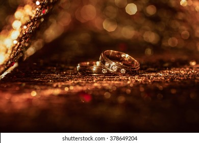 wedding rings on abstract background