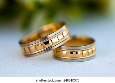 Wedding rings on a background of a wedding bouquet