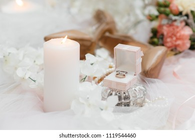 Wedding rings on the background of the bride's accessories. Wedding.