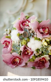 Wedding rings on a beautiful bouquet