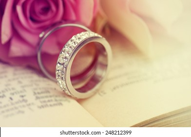 Wedding rings on the Bible.