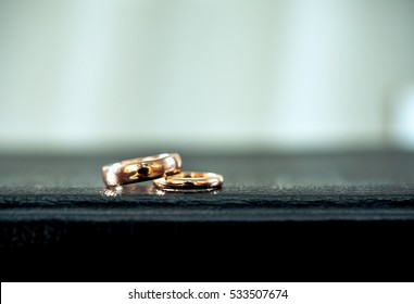 Wedding rings on Bible book. Wedding symbols, attributes. Holiday, celebration. Macro. Blur