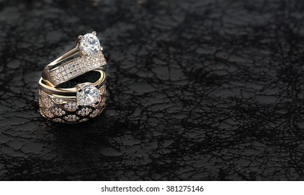 wedding rings on black backgrounds