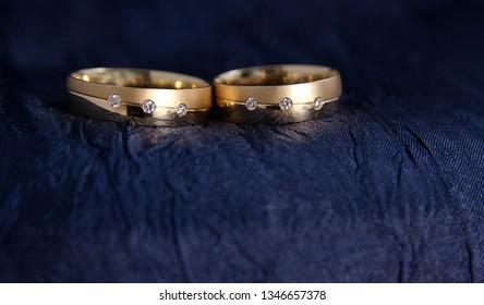 wedding rings on ble silk