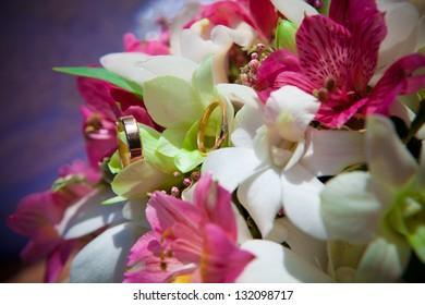Wedding rings on a wedding bouquet. Flowers