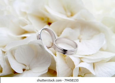Wedding rings on a bouquet of white flowers