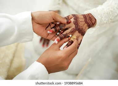 wedding rings on a couple of brides
