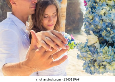 Wedding rings on couple's hands, Bali
