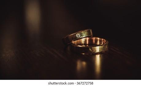 wedding rings on dark background