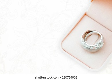 wedding rings on wedding dress, texture