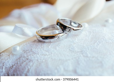 Wedding rings on the lace pillow