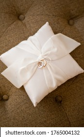 wedding rings on pillow ring bearer