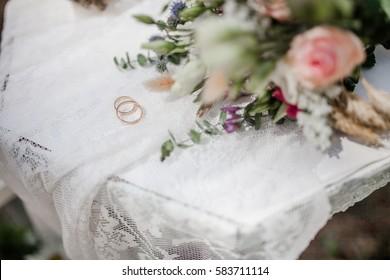 wedding rings on rustic wedding