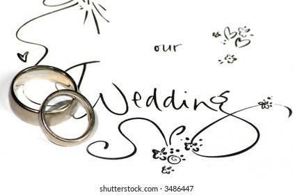 """wedding rings on a sign saying """"our wedding"""""""