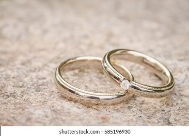Wedding rings on stone surface, Retro style