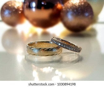 Wedding rings on the table.