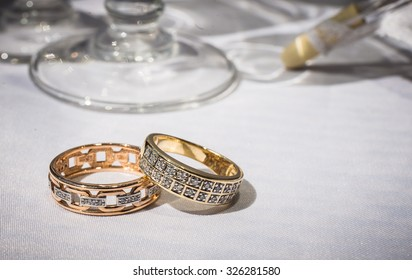 wedding rings on white background close up