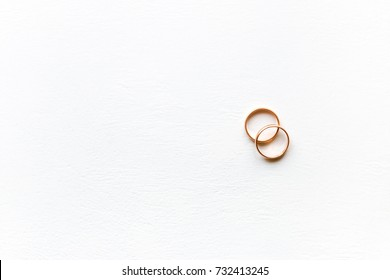 Wedding rings on a white background with place for text