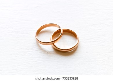 wedding rings on white background closeup