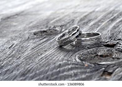 wedding rings on wood