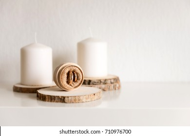 Wedding rings on the wooden stand in the room