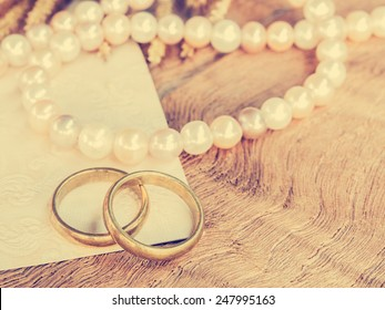 Wedding rings with pearl necklace background for wedding or valentines days concept. : Vintage style.