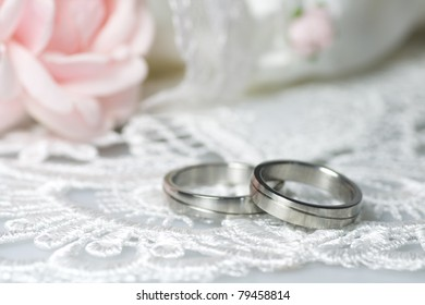 Wedding rings of platinum on a romantic background