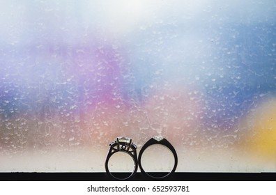 Wedding rings put in front of the mirror after rain