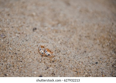 Wedding rings. Rings in the sand