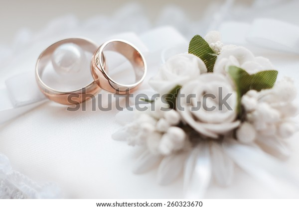 Wedding rings. Wedding symbols, attributes. Holiday, celebration. Macro. Blur