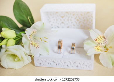 Wedding rings in a white box. Two gold bands. Wedding card with white box with bands. Wedding card with golden bands.