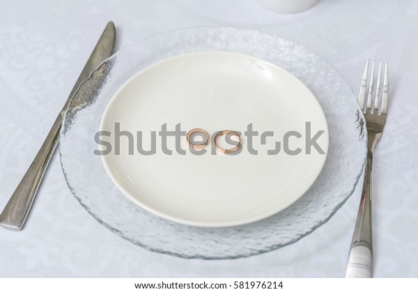 wedding rings in a white plate