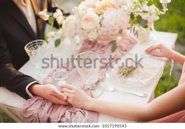 Wedding romantic dinner for two. Romantic evening together. The guy makes a declaration of love to his girlfriend