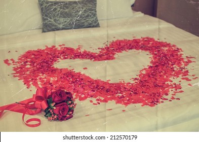 wedding rose bouquet and heart on a bed in paper film retro style for background
