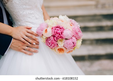 Wedding roses and peonies in the hands of the bride. Wedding in Montenegro.