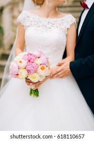 Wedding roses and peonies in the hands of the bride. Wedding in Montenegro.