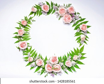 Wedding Round frame of flowers: rose, lilac, rowan leaves on a white background. Floral pattern. Copy space for text